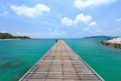 Wooden footbridge over the water near the beach Royalty Free Stock Images