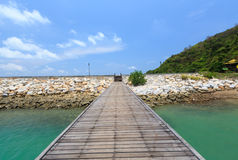 Wooden footbridge over the water near the beach. Wooden footbridge beautifuf over the water near the beach Royalty Free Stock Image