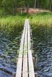 Wooden footbridge over water Stock Images