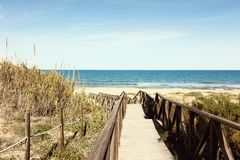 Wooden footbridge over dunes to the beach Royalty Free Stock Images