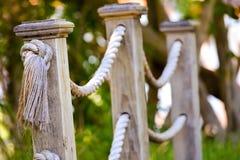 Wooden footbridge ropes in daylight Stock Photos