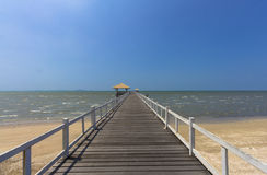 Wooden footbridge in sea view on the beach Royalty Free Stock Image