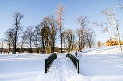 Wooden footbridge on a snow covered landscape next to Bogstadvannet lake. Winterscape Royalty Free Stock Photos