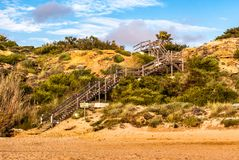 Wooden footbridge to the beach of Conil de la Frontera in Cadiz stock photos