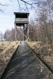 Wooden footbridge to the bird watching tower Stock Photos