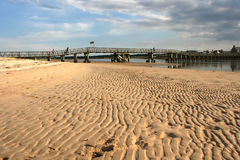 Wooden Footbridge to a Sandbar at Kinloss in Scotland with a view of the sand at low tide Stock Photos
