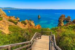 Wooden footbridge walkway to beautiful beach Royalty Free Stock Image