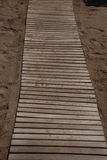 Wooden footpath on the beach Stock Photo