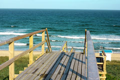 Wooden footpath through dunes at the North sea beach in Germany. Stock Photography