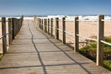 Wooden footpath through dunes at the ocean beach Stock Image