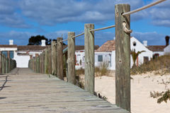 Wooden footpath through dunes at the ocean beach in Portugal Stock Image
