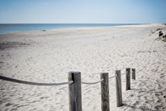 Wooden footpath through dunes at the ocean beach in Portugal Royalty Free Stock Photos