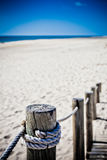Wooden footpath through dunes at the ocean beach in Portugal Stock Images