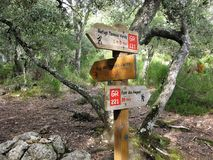 Footpath signs on a hiking trail in Mallorca. Wooden footpath sign with directions on a hiking trail through woodland on the island of Mallorca royalty free stock photo