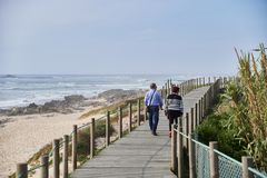 Couple on the walkway over the dunes royalty free stock image