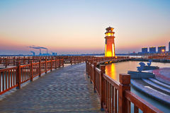 The wooden footway and lighthouse Royalty Free Stock Image