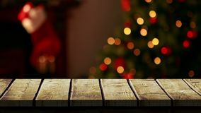 Wooden foreground with Christmas background of tree and stocking stock video