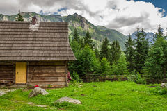 Wooden forester cottage in the foothills Stock Photo