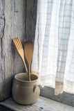 Wooden fork and spoon. In a ceramic pot Stock Image