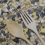 Wooden fork and spoon on oat flakes Royalty Free Stock Photography