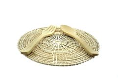 Wooden fork and spoon on rattan placemat Stock Image