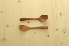 Wooden fork and spoon on table Royalty Free Stock Photo