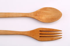 Wooden fork and wooden spoon made by Teak isolated on white back Royalty Free Stock Photo