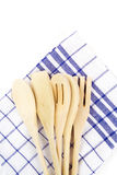 Wooden forks, spoons and spatulas on kitchen towel on w Royalty Free Stock Photo