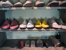 Wooden forms for the realization of craft shoes in a shoemaker`s shop royalty free stock image