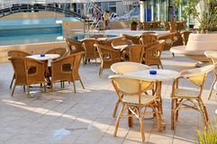 Wooden forniture by the pool of hotel Stock Image