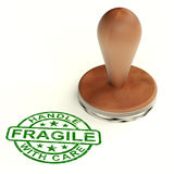 Wooden Fragile Stamp Shows Breakable Products. For Deliveries stock photo