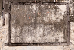 Wooden frame. Grunge cement wall with wooden frame Stock Image