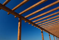 Wooden frame. A wooden frame stands agaisnt a rich blue sky Stock Photos