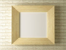 Wooden frame against a backdrop of brick wall Stock Image