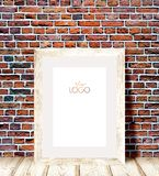 Wooden frame against a brick wall. Royalty Free Stock Images