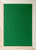 Wooden frame around green glittery paper Royalty Free Stock Photo