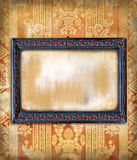 Wooden frame art deco on vintage wallpaper. An empty wooden art-deco frame on a wallpaper vintage texture with grunge effects stock photo