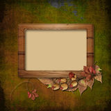 Wooden frame on autumn background Stock Images
