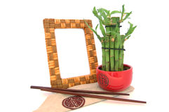 Wooden frame with baboo Royalty Free Stock Photos