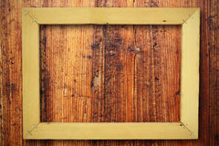 Wooden frame background. Wooden frame on old wood door Royalty Free Stock Images