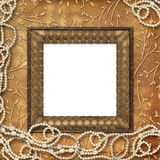 Wooden frame with beads Royalty Free Stock Images