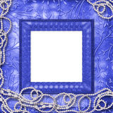 Wooden frame with beads. On the leafage ornamental background Royalty Free Stock Images