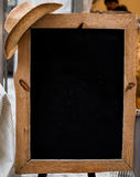 Wooden frame with black chalk board and cowboy hat Royalty Free Stock Image