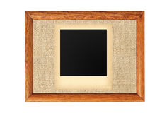 Wooden frame with blank old photo isolated on white Stock Photo