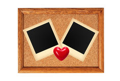 Wooden frame with blank photo and red heart isolated on whit Royalty Free Stock Image