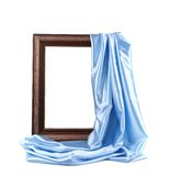 Wooden frame with blue silk. Stock Images