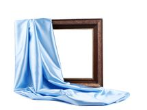 Wooden frame with blue silk Stock Images
