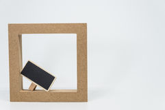 Wooden frame border and small black board with white background and selective focus. 1 Stock Photo
