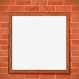 Wooden frame on brick wall Stock Image