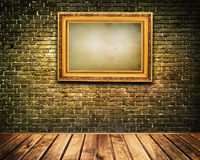 Wooden frame on bricks wall. Royalty Free Stock Images